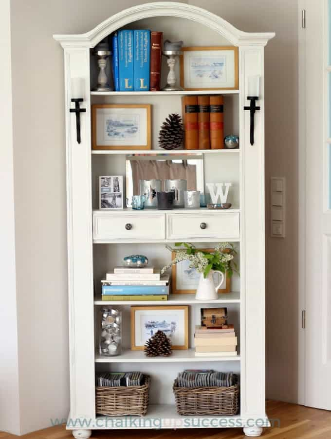 A photo of the finished & styled bookcase makeover. Painted with Annie Sloan Chalk Paint in 'Old White'.