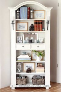 Bookcase painted with 'old white' and beautifully styled with books & pictures. chalkingupsuccess.com