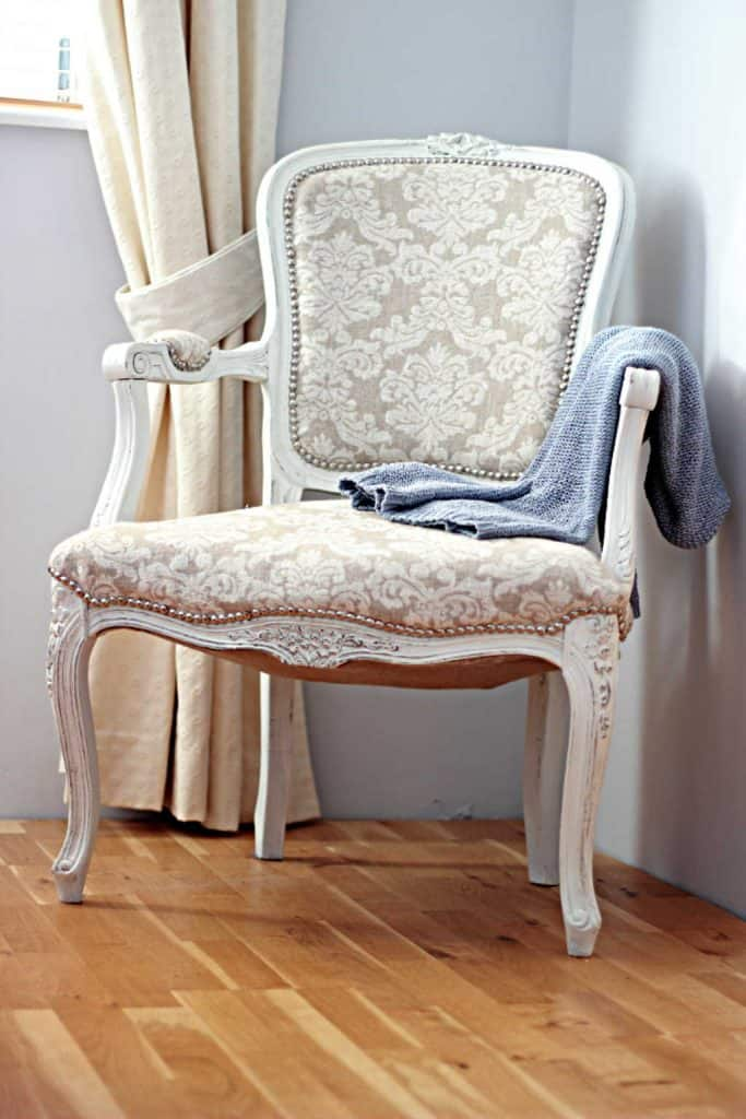 French Style Chair Makeover | Applying nail-head tacks-www.chalkingupsucess.com