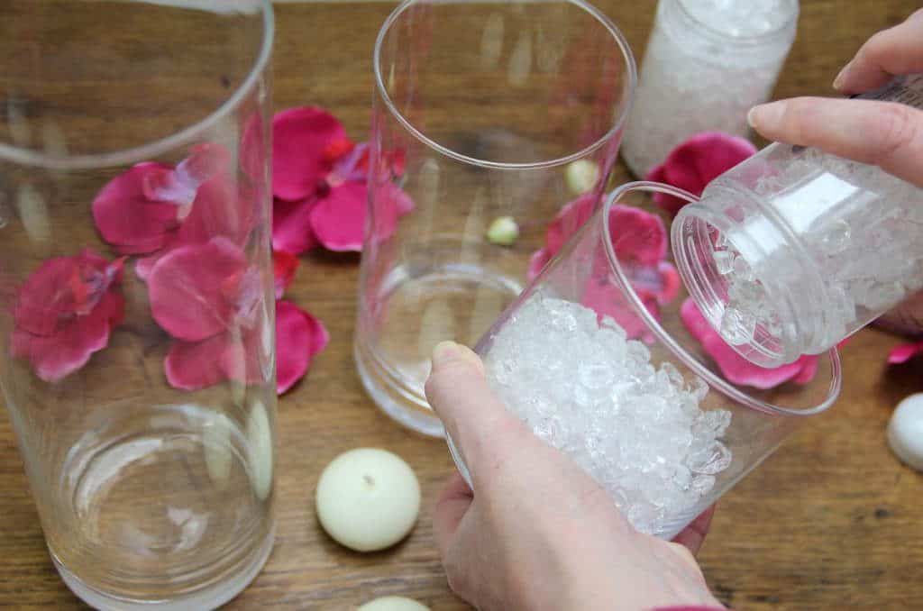 Adding the clear deco glass to the glass jars. From the post How to create a stunning valentine's day tablescape www.chalkingupsuccess.com