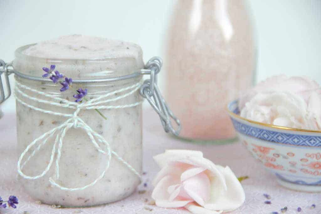 Enhance blood circulation and tighten and tone the skin and muscles with this exfoliating & nourishing lavender and rose salt scrub which may also help balance your body's pH levels. This simple recipe combines lavender, rose geranium and coconut oils with finely ground pink Himalayan salt. The calming and relaxing effect Lavender has on people makes this lavender and rose salt scrub the perfect choice for using just before bedtime, especially if you suffer from insomnia. #saltscrub #naturalskincare #coconutoil