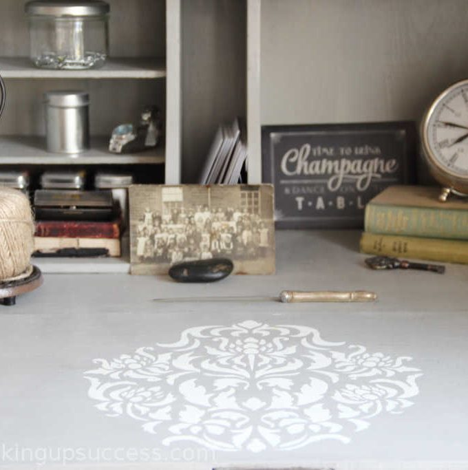 White & Grey secretary desk with damask stencil - Create a gorgeous space saving desk space for you or your child. There's loads of built in storage for files or school books and it's easily customisable with paint or stencils to suit your home style. #secretary #desk #office #diydesk #backtoschool #kidsrooms #schreibtisch #kinderzimmer #buro #vintagedesk #stencils