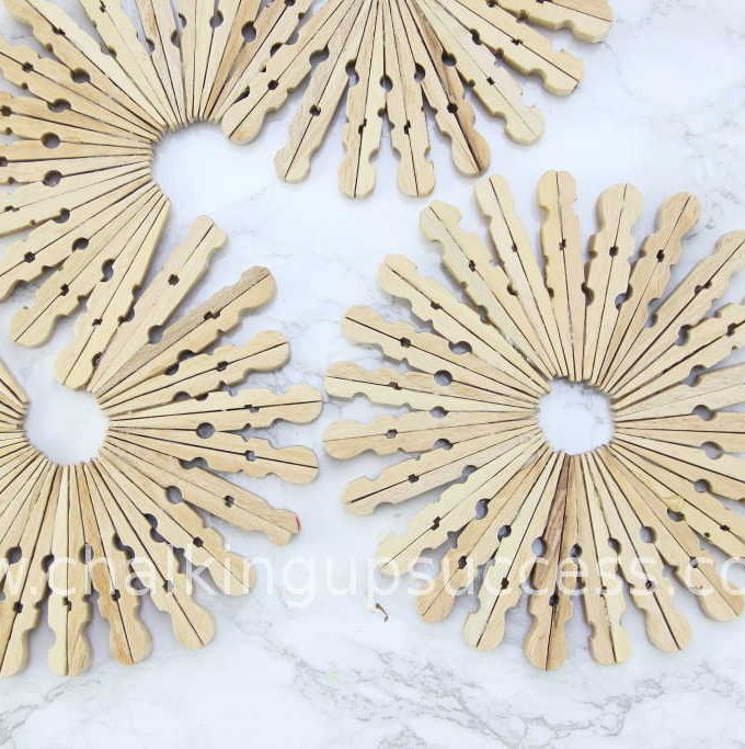 Simple but beautiful, DIY trivets made from wooden clothespins #clothespintrivet #clothespincoaster #easyhomedecor #woodenclothespins #woodenpegs #woodenclothespegs #tabledecor #craftsforkids #crafts #homedecor #diy