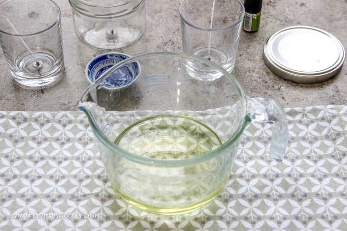 Pyrex jug with melted soy wax standing on a cooling rack