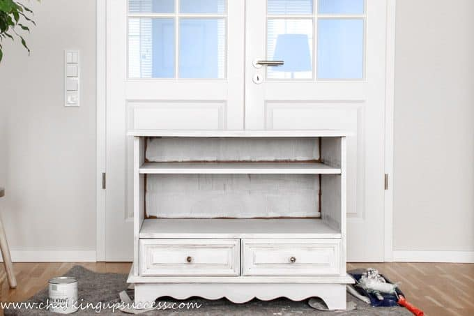Fed up with your hand-me-down furniture? Bring it bang up-to-date with a lick of paint - here's how! This is part two of the chalk paint media stand makeover series. This post covers priming and painting with Annie Sloan Chalk Paint in Duck Egg Blue. #chalkpaintedfurniture #upcycledfurniture #chalkpaint #paintedfurniture #paintingfurniture