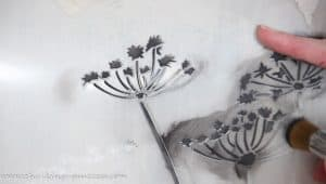 A close up of the stencil 'grasses and cow parsley'. Applying the graphite paint
