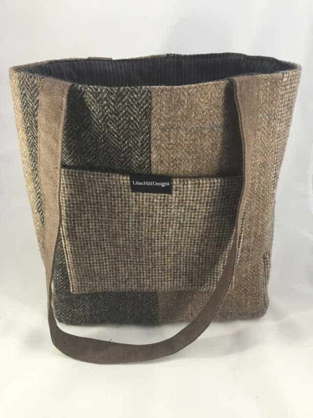 How to give a thoughtful gift that won't end up at Oxfam! Don't just give 'something' for the sake of giving. Here are some stylish eco friendly gift ideas that show you care about her AND the planet. Brown Harris Tweed tote bag made from recycled tweed fabric. Has a pocket on the front. Looks very stylish.