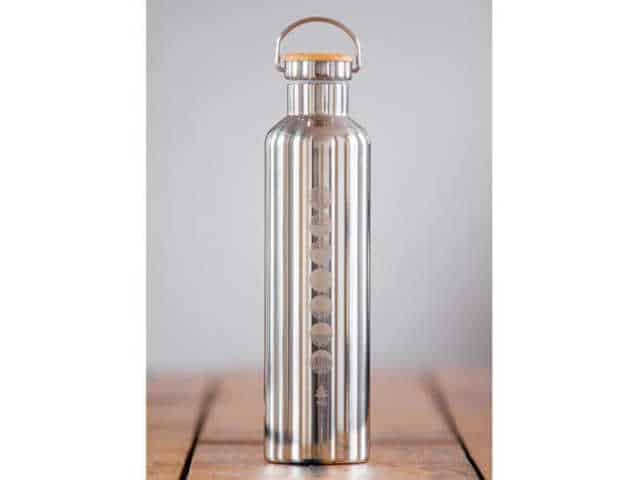 How to give a thoughtful gift that won't end up at Oxfam! Don't just give 'something' for the sake of giving. Here are some stylish eco friendly gift ideas that show you care about her AND the planet. Stylish silver water bottle with screw on cork lid. Has yoga symbols engraved in one long row on the front. Made to order.