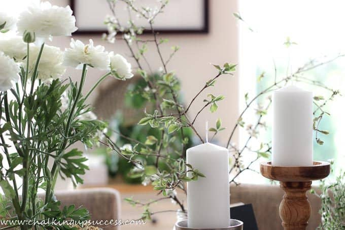 white flowers and candles as part of an Easter tablescape from the blog Chalking Up Success.