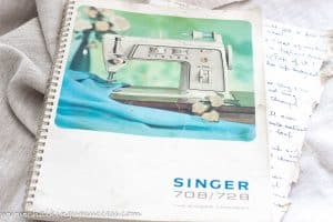 Shows an instruction manual for the 'Singer' sewing machine 'Touch & Sew' - from the blog post 'How to cope with letting go of sentimental items' by Chalking Up Success dot com