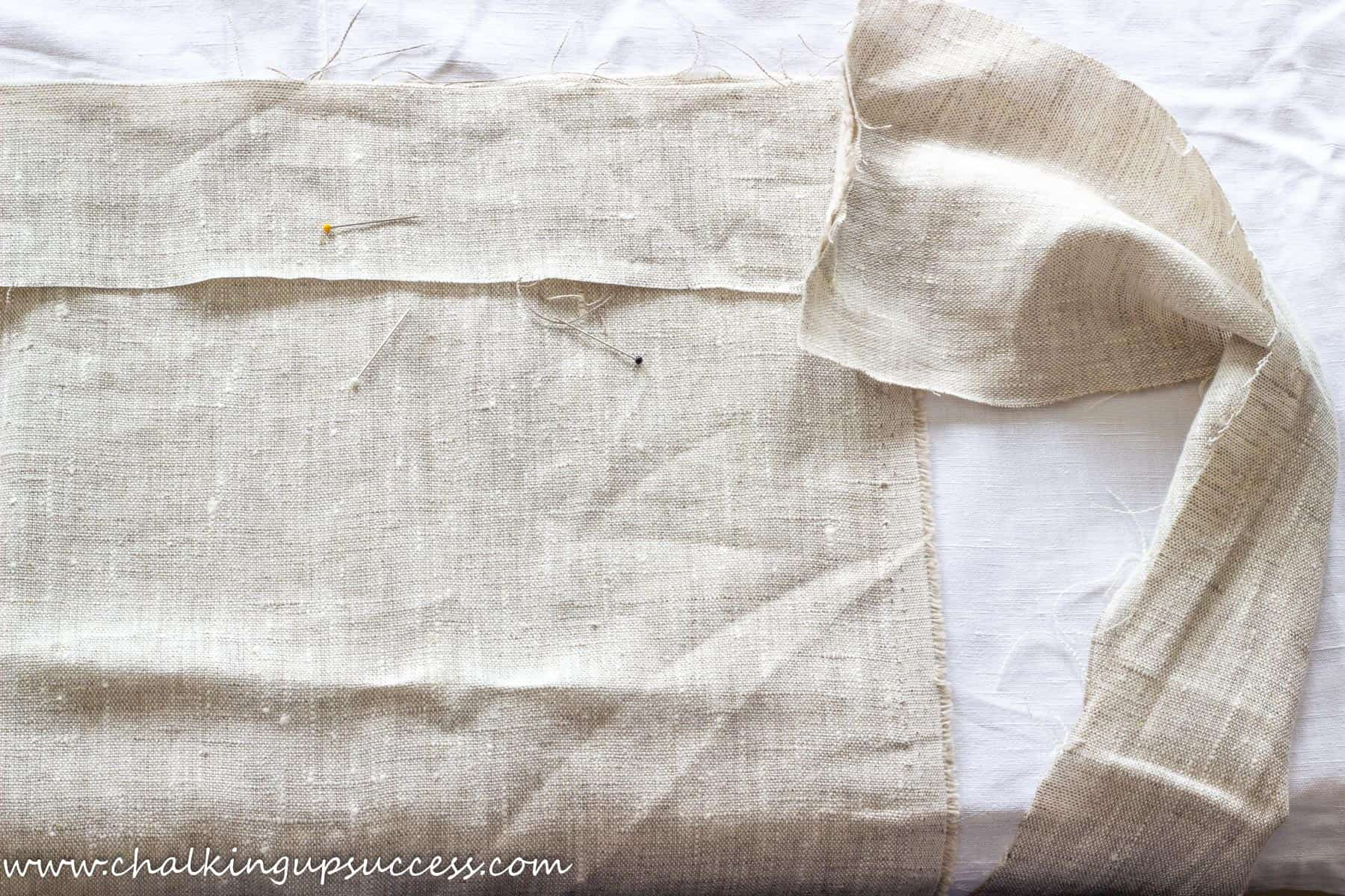 Showing the top section of the linen cushion fabric