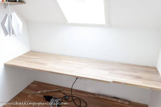 Oak corner desk in a small office at the top of the stairs - longest piece installed.