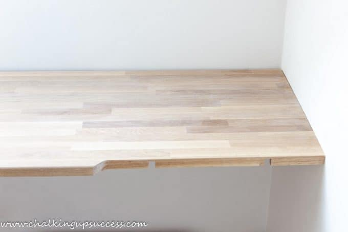 Showing the corner desk where the two oak pieces join together