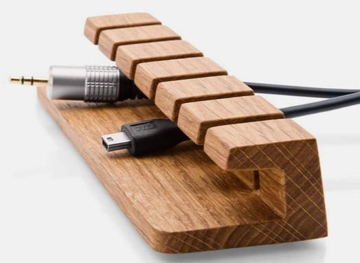 Wooden Cable Organiser - If you'd like to know how to make your office more sustainable here are some of the gorgeous accessories that you can buy for your desk and workplace today, to help you reduce plastic in your home and create an eco-friendly office space. #ecofriendlydecor #ecofriendlyproducts #ecofriendlygifts #ecofriendlyliving #ecofriendlyideas #ecofriendlytips #ecofriendly  #sustainability #sustainableliving #zerowaste #ecofriendly #office #officesetup  #ecofriendlyofficesupplies  #greenoffice #ecofriendlyhome #homeofficeideas #homeofficemakeover #sustainablelivingideas