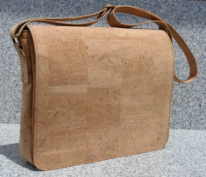 Cork messenger bag - If you'd like to know how to make your office more sustainable here are some of the gorgeous accessories that you can buy for your desk and workplace today, to help you reduce plastic in your home and create an eco-friendly office space. #ecofriendlydecor #ecofriendlyproducts #ecofriendlygifts #ecofriendlyliving #ecofriendlyideas #ecofriendlytips #ecofriendly  #sustainability #sustainableliving #zerowaste #ecofriendly #office #officesetup  #ecofriendlyofficesupplies  #greenoffice #ecofriendlyhome #homeofficeideas #homeofficemakeover #sustainablelivingideas
