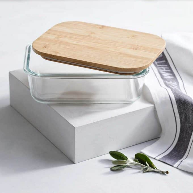 Glass food container with wooden lid - If you'd like to know how to make your office more sustainable here are some of the gorgeous accessories that you can buy for your desk and workplace today, to help you reduce plastic in your home and create an eco-friendly office space. #ecofriendlydecor #ecofriendlyproducts #ecofriendlygifts #ecofriendlyliving #ecofriendlyideas #ecofriendlytips #ecofriendly  #sustainability #sustainableliving #zerowaste #ecofriendly #office #officesetup  #ecofriendlyofficesupplies  #greenoffice #ecofriendlyhome #homeofficeideas #homeofficemakeover #sustainablelivingideas
