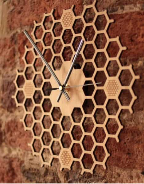 Homeycomb clock - If you'd like to know how to make your office more sustainable here are some of the gorgeous accessories that you can buy for your desk and workplace today, to help you reduce plastic in your home and create an eco-friendly office space. #ecofriendlydecor #ecofriendlyproducts #ecofriendlygifts #ecofriendlyliving #ecofriendlyideas #ecofriendlytips #ecofriendly  #sustainability #sustainableliving #zerowaste #ecofriendly #office #officesetup  #ecofriendlyofficesupplies  #greenoffice #ecofriendlyhome #homeofficeideas #homeofficemakeover #sustainablelivingideas
