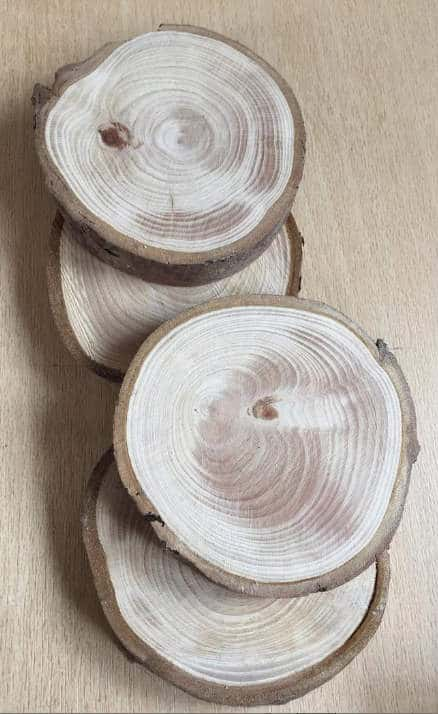 Wood slice coasters - If you'd like to know how to make your office more sustainable here are some of the gorgeous accessories that you can buy for your desk and workplace today, to help you reduce plastic in your home and create an eco-friendly office space. #ecofriendlydecor #ecofriendlyproducts #ecofriendlygifts #ecofriendlyliving #ecofriendlyideas #ecofriendlytips #ecofriendly  #sustainability #sustainableliving #zerowaste #ecofriendly #office #officesetup  #ecofriendlyofficesupplies  #greenoffice #ecofriendlyhome #homeofficeideas #homeofficemakeover #sustainablelivingideas