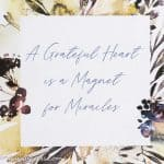 "Quote ""A grateful heart is a Magnet for Miracles"" on the watercolour background of autumn flowers"