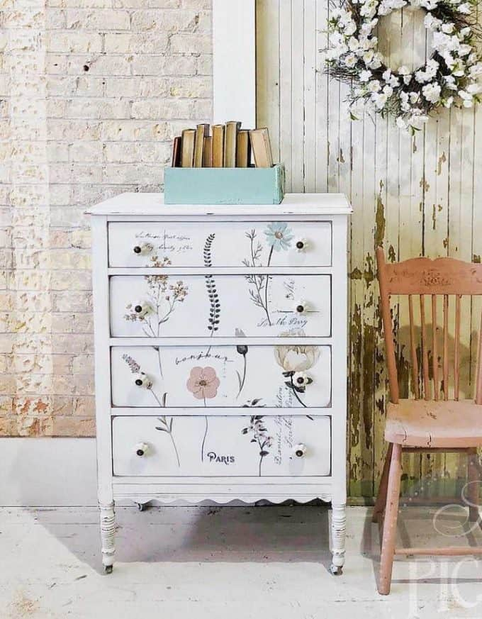 You can easily update old furniture with these floral furniture transfers. Single summer flowers on a white painted dresser.