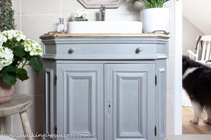 An old dresser transformed into a beautiful bathroom vanity with Paris Grey Chalk Paint - a really easy way to update old furniture.