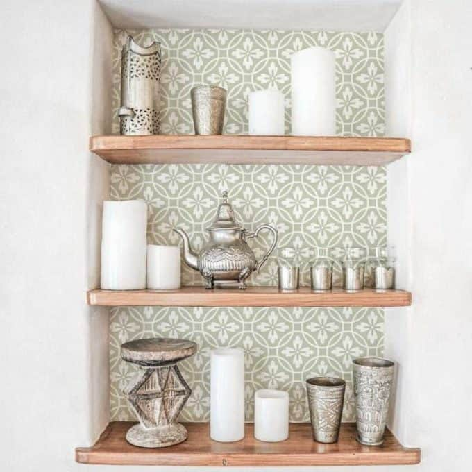 The back of these wooden shelves has been given a refresh with sage green and white flowers and circles design.