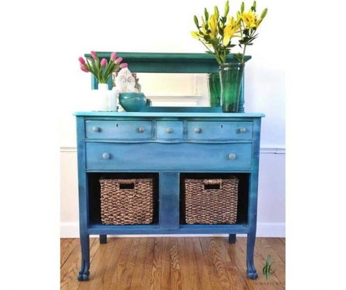 Blue painted hutch with baskets instead of drawers.