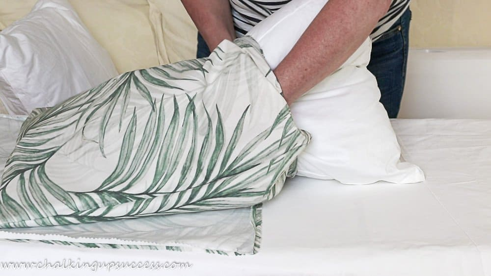 Insert the pillow into the pillow cover