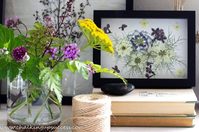 A beautiful pressed flower print made with a collage of pressed garden flowers.