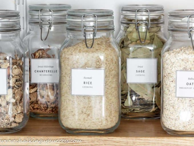 Spring top pantry jars on a shelf in the pantry - How to organize a small under-stair pantry