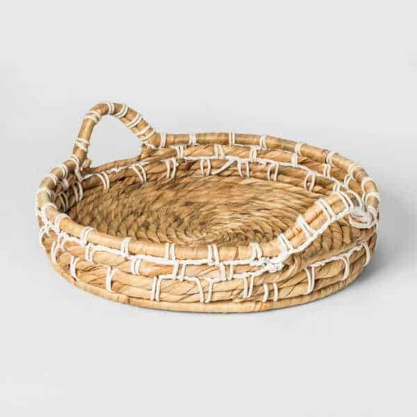 Round basket with handles, made of seagrass