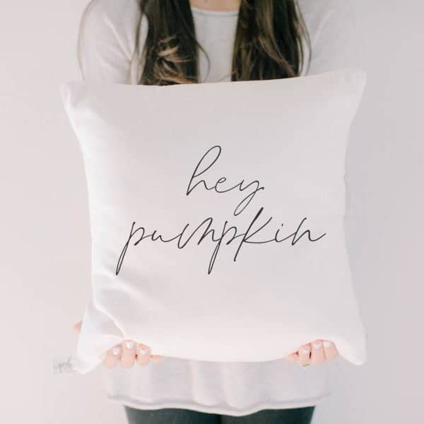Autumn home decor finds. 'Hey Pumpkin' white pillow with black text.