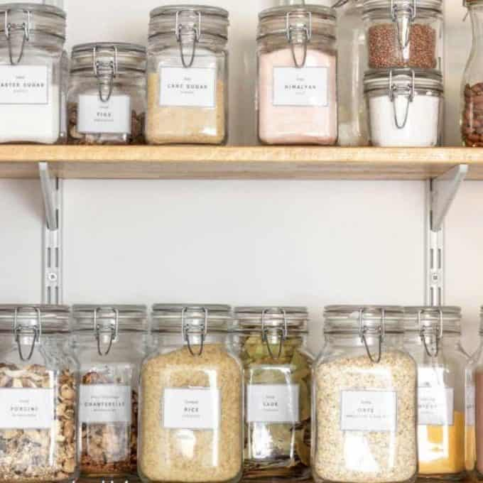 Clear glass jars on a shelf in a pantry - How to organize a small under-stair pantry