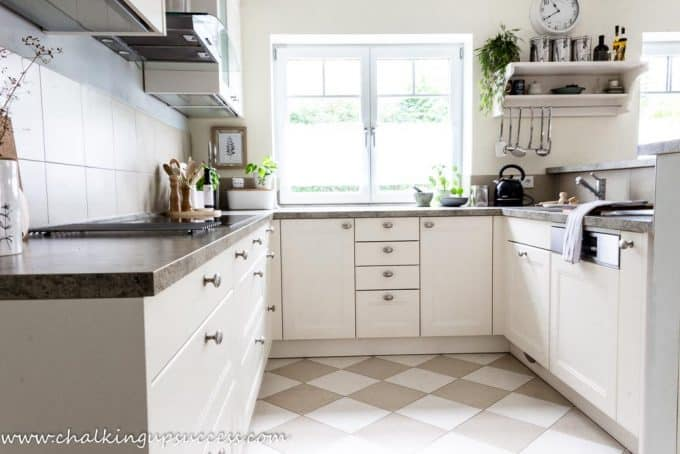 White kitchen decorated for an autumn home tour.