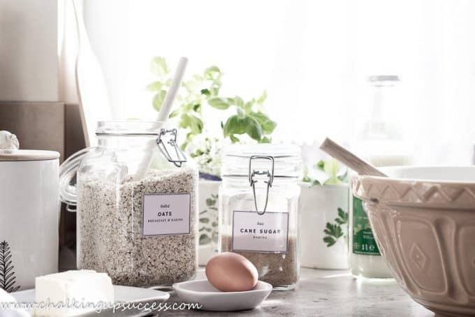Autumn home tour in the kitchen - kitchen counter with glass spring top containers, a mason and cash mixing bowl and baking ingredients.