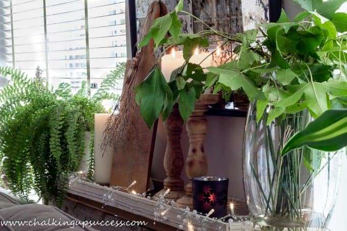 Autumn home tour - behind the sofa console table decorated with candles and plants.