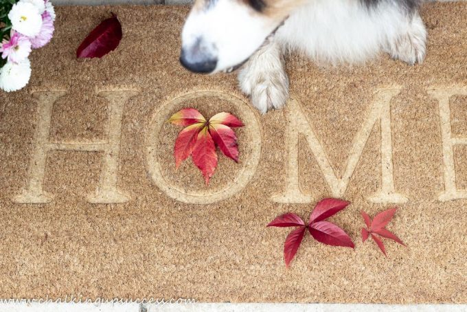 A welcome mat with the words 'HOME'.