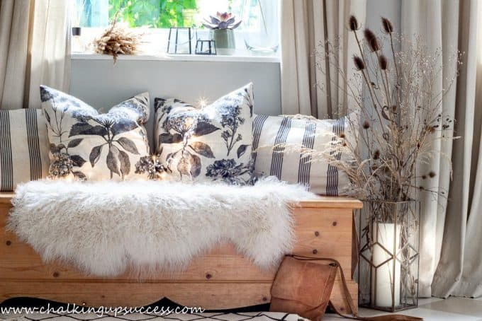 First stop in the home tour - cosy bench decorated with a curly hair sheepskin and farmhouse style pillows.