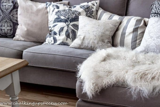 Autumn home tour - brown sofa with black and beige throw pillows.