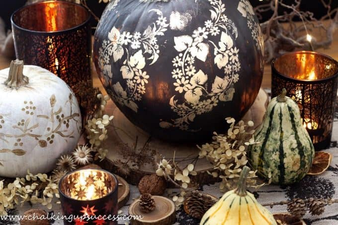 cute painted pumpkins in black and gold and white and gold. Autumn table centrepeice.