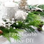 Farmhouse style wood pedestal tray decorated for Christmas