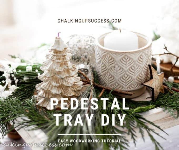 Christmas tree candle on a wood pedestal tray