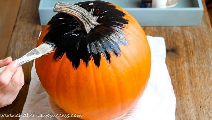 Painting an orange pumpkin black - cute painted pumpkin ideas