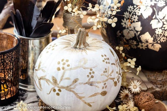 cute painted pumpkins in white with a handpainted floral design in gold