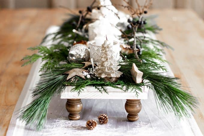 White wood pedestal tray with contrasting oak legs decorated for Christmas