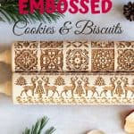 Pinterest Image - Christmas flatlay image with two embossed rolling pins. Titled, How to make Christmas cookies with an embossed rolling pin