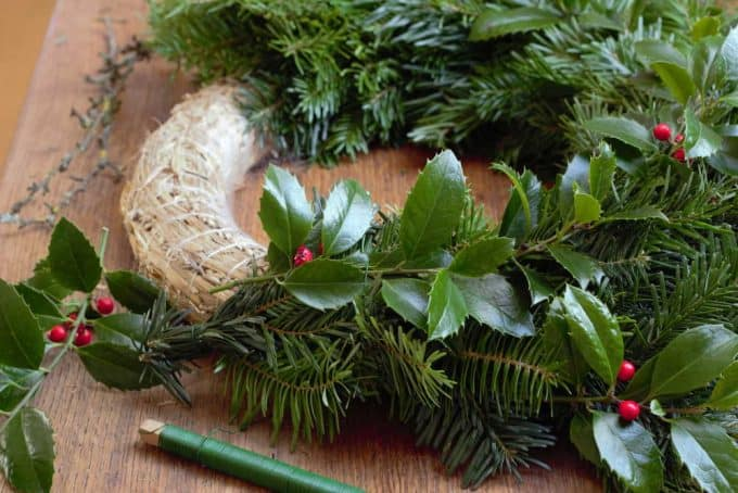 straw wreath bound with holly and fir