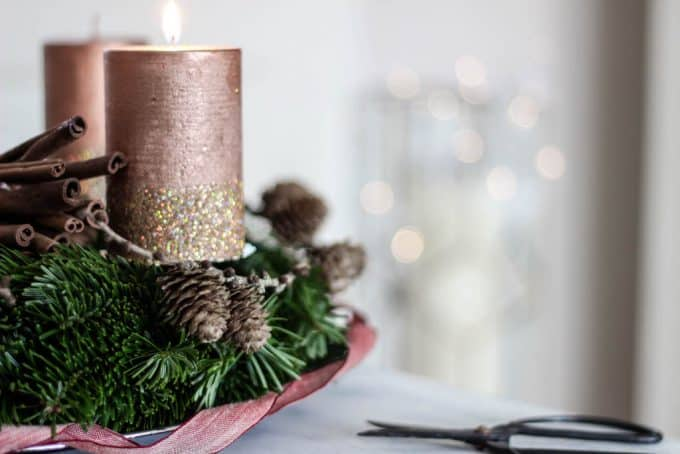 Side view of a fresh evergreen Advent wreath with pink candles