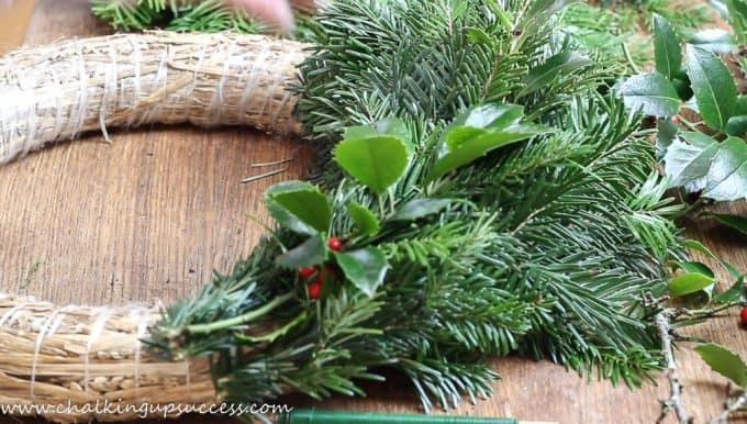 A fresh evergreen wreath being made