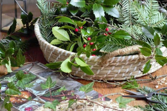 A basket of evergreen branches.